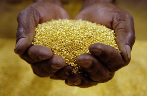 A worker holds gold granules at the Rand Refinery, the largest and most modern gold refinery in the world, in Germiston, South Africa, on June 9, 2006. Photographer: Henner Frankenfeld/Bloomberg News